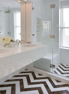 White bathroom. LOVE the chevron tile floor!!
