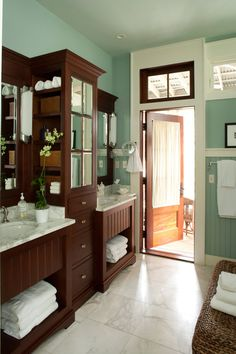 Just because it's the standard way doesn't mean it's the best way for your home. Research different cabinet configurations to find the best layout for your master bath. Instead of a traditional upper cabinet with doors on the front, this configuration offers separate shelves for each vanity.