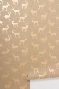 Metallic Stag Wallpaper #anthropologie perhaps paired with bare wood floors, and navy-cream accents