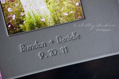 Cover Imprinting Centered Below Cover Inset Photo. Imprinting Style = Modern. Imprint Color = Branded. Imprinting Case = Upper/Lower. The Cover Material = Euro Gray Leather. (Source: http://www.shelby-studios.com/blog/?p=7798)
