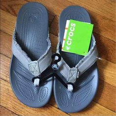 Crocs Flip Flops Authentic Crocs flip flops, brand new with tags. Never worn. Unisex will fit mens size 8 and women's size 10. Will ship same day or next day. crocs Shoes Slippers