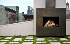 An outdoor fireplace in a West Village project by MADE LLC.