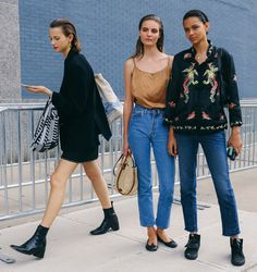 Mali Koopman, Tilda Lindstam and Binx Walton spotted on the street at New York Fashion Week. Photographed by Phil Oh.