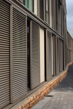 Louvre shutters are highly functional in residential applications with balconies or glass facades. They offer shading and privacy and are resistant to all weather conditions and wind loads. Click on the picture for more information & inspiration. Cladding Design, House Cladding, Facade Design, Facade House, House Windows, Window Shutters Exterior, Outdoor Shutters, Outdoor Blinds, Home Window Grill Design