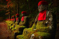 """Reincarnation by Jahl Marshall  """"This photo was captured while on a stroll alongside the Daiya River in Nikko, Japan. The peaceful meditating Buddhas inspired thoughts of reincarnation."""""""