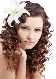 Shiny Spiral Hairstyle with Flower Accessory