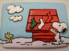 Snoopy hanging socks on his dog house, decorated cookie by sweetTcakeS