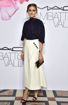 Olivia palermo in white pencil wrap skirt at M.A.C Cosmetics and Giambattista Valli Floral Obsession Ball held at Opera Garnier in Paris, France. She wore