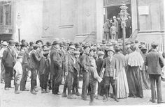 1904 . crowds gather outside St Marks, 6th street, awaiting news of their loved ones after the General Slocum Disaster.