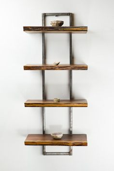 """A perfect addition to any room, this beautiful live edge Black Walnut shelf is 4-tier with a welded metal frame. Each shelf maintains the live edge and measures 11 3/4"""" x 6 1/4"""" x 1"""" and they stand 28"""