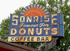 Old route 66 sign for Sonrise Donuts & Coffee bar. It has a great weathered patina look