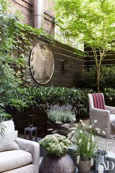 Step Inside Monique Gibson's NYC Townhouse In the garden, designed by Harrison Green, custom armchairs by August Studios wear a Holly Hunt acrylic. Vintage highway mirror on wall. Landscaping Near Me, Small Backyard Landscaping, Backyard Ideas, Landscaping Ideas, Landscaping Software, Backyard Designs, Pool Backyard, Garden Mirrors, Outdoor Mirrors Garden
