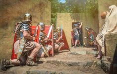 Roman legionaries storming a home in the Middle East