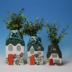 Adorable house vases.  You can paint them at Art & Soul