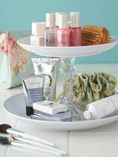 Dollar Store DIY bathroom storage. Use plates and a candlestick holder!