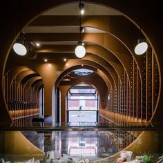 Wine cellar or artwork? Wine Shop by Zooco Studio uses warm colors and sweeping archways to bring artistry and practicality together. Photo: Imagen Subliminal De Vinos Y Viandas Commercial Interior Design, Best Interior Design, Commercial Interiors, Wine Shop Interior, Retail Interior, Mario Botta, Casa Farnsworth, Design Competitions, Shop Interiors