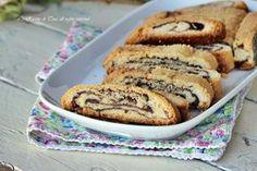 Biscotti arrotolati alla nutella,biscotti golosissimi,croccanti e dal morbido ripieno!Semplici e veloci,la frolla poi non deve riposare!