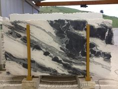 Come on, you know if you had unlimited money to throw at a kitchen you'd pick an outrageously expensive slab of marble for your countertops too...
