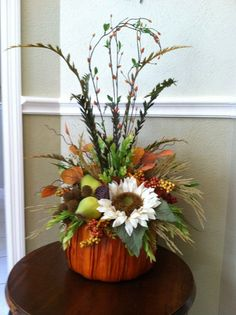 Large Fall Silk Floral Arrangement in an orange pumpkin basket. Features fall leaves & berries, greenery, cream sunflower, faux green pears and Thanksgiving Decorations Outdoor, Thanksgiving Table Settings, Thanksgiving Centerpieces, Diy Thanksgiving, Holiday Tablescape, Holiday Decor, Pumpkin Arrangements, Fall Floral Arrangements, Pumpkin Centerpieces