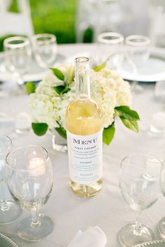 Great idea! Why not put the menu on the wine bottles at your wedding? It'll save paper and money!