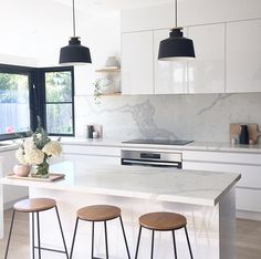Clean white kitchen all flushed cabinets minimal