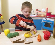 This wooden play food set is perfect for young chefs looking to explore a little mealtime fun without the mess! Cutting the food makes a satisfying 'crunch' and provides a playful introduction to concepts of 'whole,' 'part,' and fractions Kids Role Play, Pretend Play, Wooden Play Food, Play Food Set, Teacher Supplies, Melissa & Doug, Coffee Set, Oriental Trading, Kids Toys