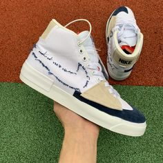 The white canvas upper features a misplaced suede overlay and Swoosh, the latter leaving behind frayed stitching on the lateral side. Latest Sneakers, Sneakers Fashion, Fashion Shoes, Sneakers Nike, Jordan Shoes New Release, Blue Toes, Sports Brands, Shoes Uk, Jordan 1 Retro High