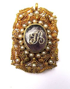 locket, c. 1800-10, gold, filigree and peals; on the back there is a compartment for hair.