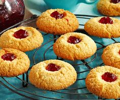 These delicious chewy coconut jam drops biscuits are easy to make and great for morning tea. The cookies are complete with a raspberry jam centre. Coconut Recipes, Baking Recipes, Cookie Recipes, Coconut Desserts, Sponge Cake Recipes, Drink Recipes, Coconut Biscuits, Coconut Cookies, Mugs
