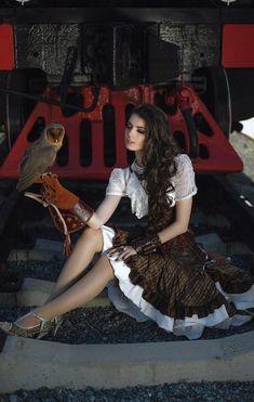 A girl with an owl https://madburner.com #steampunkfashion,