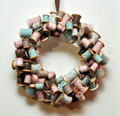 if I ever have a craft/sewing room...or cover spools with Christmas or other Holiday ribbon to make a holiday wreath