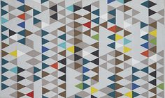 Triangular patterned rug Geometric Design Inspiration For Your Next Accent Wall Or DIY Project