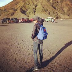 bromo mountain , steps on the dust, with superman's backpack