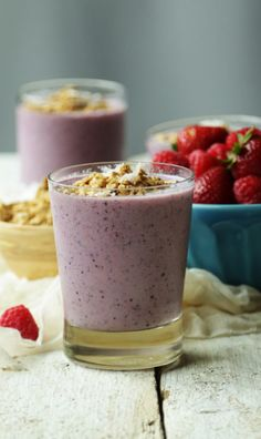Coconut milk smoothie with vanilla Greek yogurt, fresh berries, banana and @bobsredmill honey oat granola.