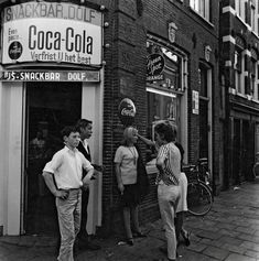 1960's. Youth in the Jordaan section of Amsterdam gather at snackbar Dolf in the Willemstraat. Photo Dolf Toussaint. #amsterdam #1960 #Willemstraat #Jordaan