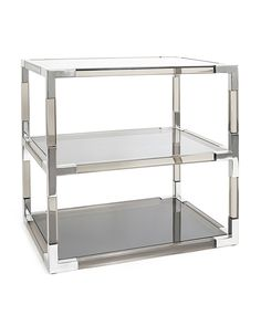 "Side table made of smoke-hued Lucite and nickel with protective coating. Tempered-glass shelves and top. Adjustable levelers on the underside of the feet. Assembly required. 28""W x 20""D x 26""T. Import"
