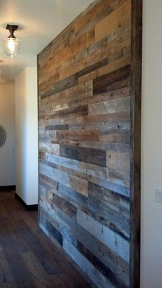 at front entry add a wood floating shelf with rustic coat and key hooks under the floating shelf