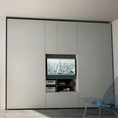 FLAT - Contemporary wardrobe / wooden / folding door / with tv screen by CACCARO