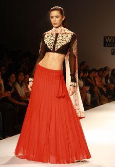 Models walk the ramp designer Joy Mitra show at Wills Lifestyle India Fashion Week 2013 in New Delhi.