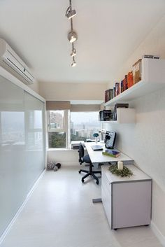 Pacific Palisades (Hong Kong) modern home office - window at end lets light in.