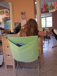 HomeSchool notebook pockets for back of chairs... using Pillowcases.  Love that this is washable too!