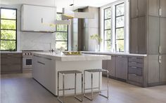 Leverone Design. Cabinetry style/finish, counters, hood.