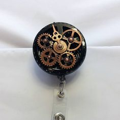 Check out this item in my Etsy shop https://www.etsy.com/listing/526173348/steampunk-clock-gears-badge-reel