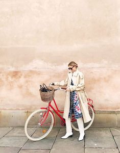 Spring street style outfit ideas 2018: try your trench with a floral dress layered over jeans and with white boots