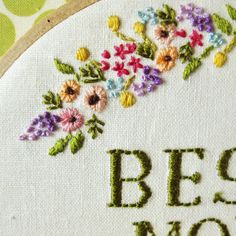 Embroidered flowers and I like the way the letters are stitched.