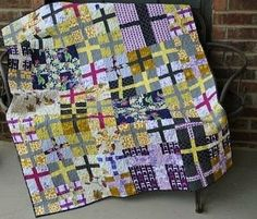 purple and yellow cross quilt - so modern and looks relativity simple.
