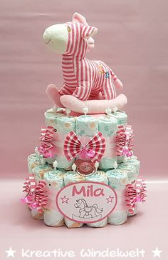 """Windeltorte """"Schaukelpferd"""" + Schnuller Rosa ♥ Cheap Baby Shower Gifts, Baby Shower Gift Basket, Inexpensive Christmas Gifts, Christmas Gifts For Coworkers, Valentine Crafts, Valentine Day Gifts, Pink Diaper Cakes, Nappy Cake, Valentines Day Couple"""