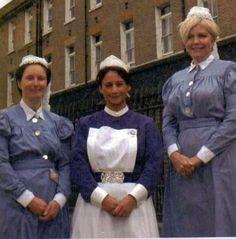 Nurses from the Royal London Hospital modelling vintage uniforms.