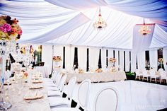 Gorgeous tent! So light and airy- the colours and flowers are perfect for a spring wedding!