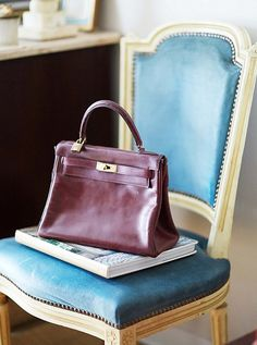 What better resting place for a vintage Hermes Kelly bag than an antique Louis dining chair?!